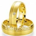 Alianças curitiba WM2756 Modelo: Aliança de noivado e casamento Material: Ouro Amarelo 18k 750 Peso: 11 gramas Pedra(s): 1 diamante de 1 ponto 1 rubi Largura: 5.5 milímetros Formato: Anatômico Baixo Acabamento: Liso c/ Friso Fosco