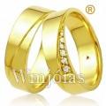 Alianças de casamento WM2961 Modelo: Alianças de noivado e casamento Material: Ouro Amarelo 18k 750 Peso: 10 gramas o par Pedra(s): 6 diamantes de 1 ponto 1 rubi Largura: 5 milímetros Formato: Anatômico Baixo Acabamento: Liso