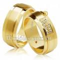 Alianças de casamento WM2628 Modelo: Aliança de noivado e casamento Material: Ouro Amarelo 18k 750 Peso: 12 gramas o par Pedra(s): 10 diamante de 1 ponto 1 rubi Largura: 6 milímetros Formato: Anatômico Baixo Acabamento: Liso e Fosco