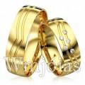 Alianças de casamento WM2926 Modelo: Alianças de casamento Material: Ouro Amarelo 18k 750 Peso: 14 gramas o par Pedra(s): 5 diamantes de 1 ponto 1 rubi Largura: 7 milímetros Formato: Anatômico Baixo Acabamento: Liso