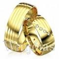 Alianças de casamento WM2924 Modelo: Alianças de casamento Material: Ouro Amarelo 18k 750 Peso: 14 gramas o par Pedra(s): 4 diamantes de 1 ponto 1 rubi Largura: 7 milímetros Formato: Anatômico Baixo Acabamento: Liso
