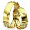 Alianças de casamento WM2923 Modelo: Alianças de casamento Material: Ouro Amarelo 18k 750 Peso: 10 gramas Pedra(s): 1 diamante de 1 ponto 1 rubi Largura: 5 milímetros Formato: Anatômico Baixo Acabamento: Liso